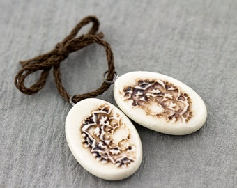Oval mandala porcelain pendants|Iron oxide and clear glaze