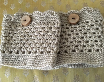 Tan boot cuffs with button detail