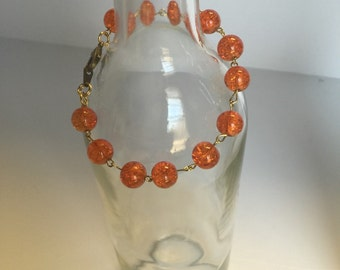 Linked orange marble beaded bracelet