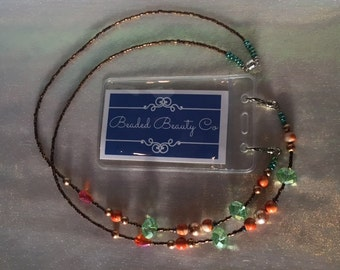 Beaded Lanyard with ID badge holder ~ orange and green with bronze accents