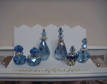 6 beautiful clear crystal perfume bottles, for your dolls house.