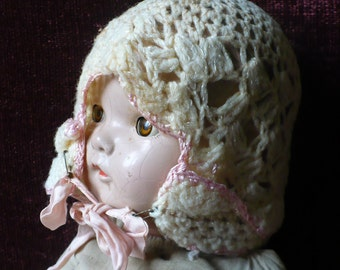 Antique baby hat, crotchet, cream color with pink edge