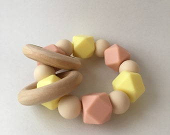 Cream Yellow, Peachy, and Navajo Silicone Teething Ring with 2 Wood Rings