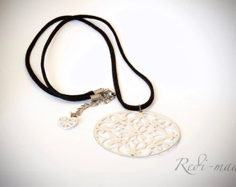 Necklace - black cord with a big white pendant
