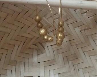 Terracotta gold beads in hoop earrings