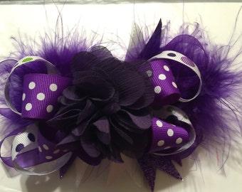 Purple polk a dot flower bow