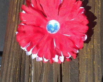 Handmade red and white flower clip with gem center