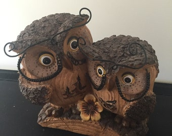 2 Owl Statue and a single Owl