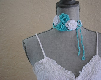 Baby blue and white flower and rings necklace