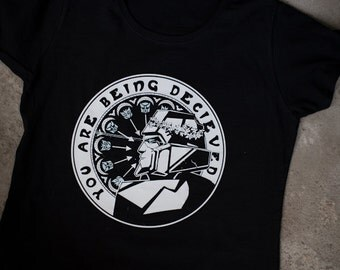 TF t-shirt You Are Being Deceived