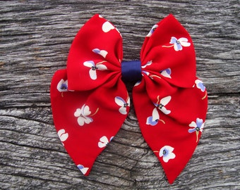 Bow tie brooch pin red with blue flowers
