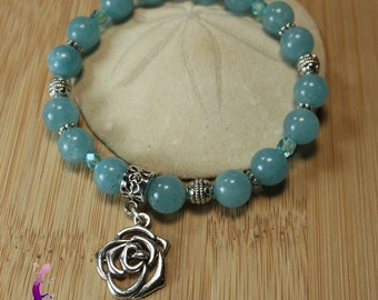 Bracelet in aquamarine with Silver Flower charm