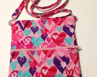Cross Body Bag wth adjustable strap;  lightweight; small and comfortable;  holds all necessities