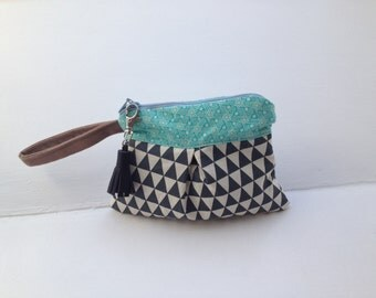 Clutch bag with leather tassel