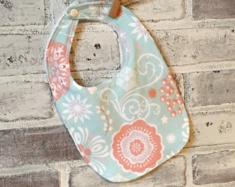 Flowered pattern baby bib white/pink/peach/pale teal blue