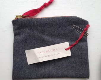 Grey wool purse with red zip and organic cotton gingham lining.