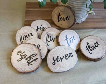 Hand made wood slice table numbers for your rustic wedding or event. With or with out moss finish. Calligraphy decal.