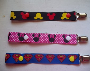 Minnie Mouse, Mickey Mouse, and Superman pacifier clip