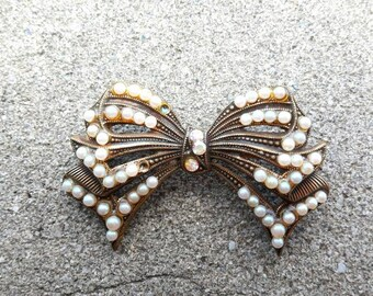 Bronze bow brooch with pearls and Swarovski