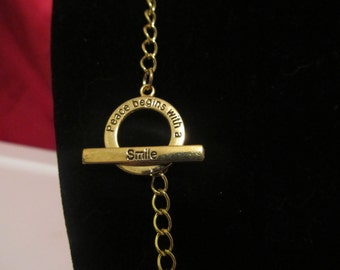 Peace begins with a smile Toggle Necklace and Bracelet