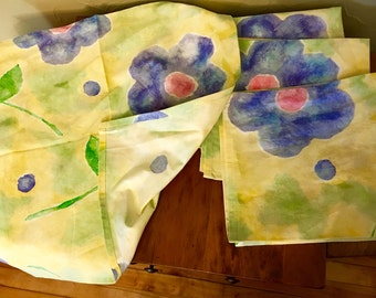 1950's inspired fabric napkins. Floral motif, vibrant yellow, green & blue.