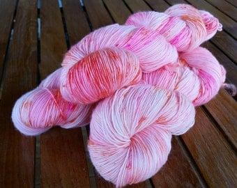 Papaya, hand dyed merino single ply hot yarn