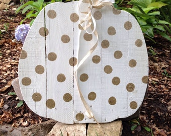 White pumpkin with gold polka dots!