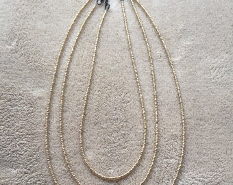 Gold seed beaded necklace with black clasp