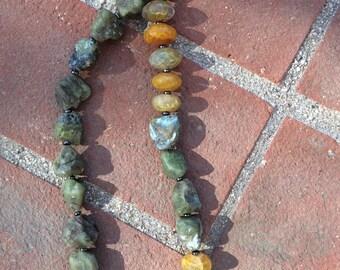 polished agate stone and afghan tumbled agate in raw form