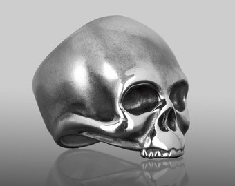 "Mens skull ring, handmade in sterling silver.  Edgy, rock n roll, biker jewelry.  Our ""KEITH"" skull ring was inspired by Keith Richards."