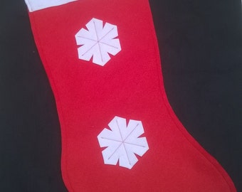 large bright red felt Christmas stocking white cuff red gingham hanging ribbon and detail white snowflake