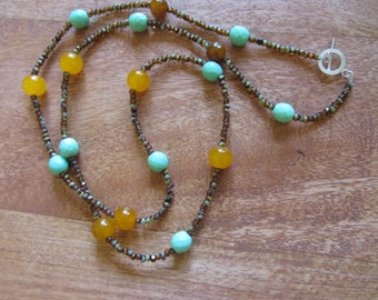 Long casual fashion chain in acqua and amber tones