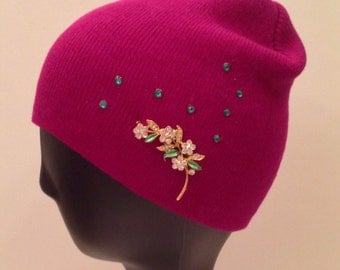 Bedazzled magenta beanie decorated with broach