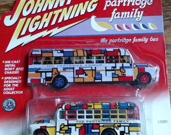 NEW the Partridge Family Tour Bus new on card Johnny Lightning