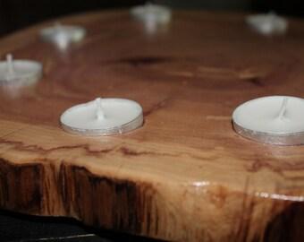 Nine tealight finished wood slice holder/display.