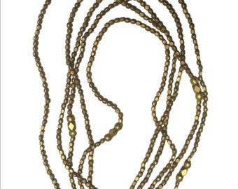 Brass beaded necklace.