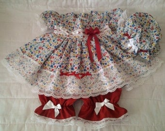 Red Flowerfed outfit with red blue bloomers and mop cap