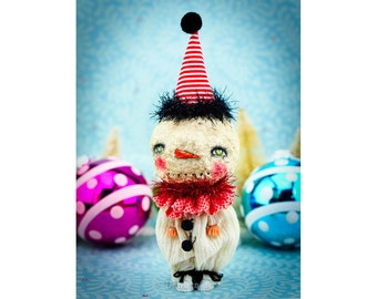 Original Christmas decoration created by mixed media artist Danita, a snowman clown art doll from a recycled toy dressed in handmade clothes