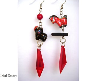 Avant garde dog and pony show statement dangle earrings.