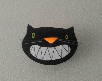 halloween...wall sconce...black cat nervous grin