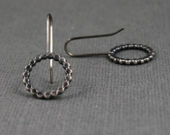 Sterling silver oxidized hammered french wire earrings.