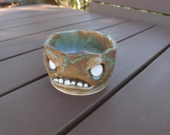 Hand-thrown ceramic zombie planter