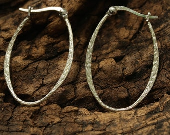 Silver loops earrings with texture