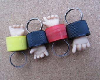 Baby Fight Club  - upcycled baby doll hand bottle cap ring - yellow right