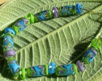 Lampwork beads/glass beads/handmade lampwork/artisan lampwork/sra handmade glass/green/blue/lavender/ribbons/