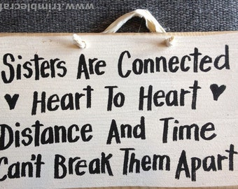 Sisters connected heart to heart Distance time cant break apart sign