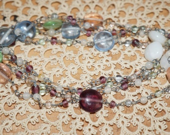 Antique glass necklace strand    Glass beads on metal wire