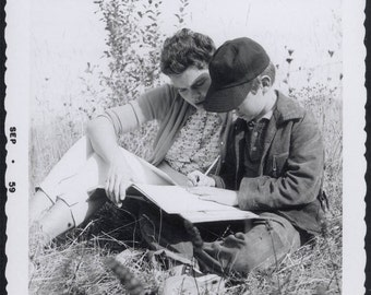 vintage photo 1959 Young Lady Doing Homework w Boy in Field snapshot