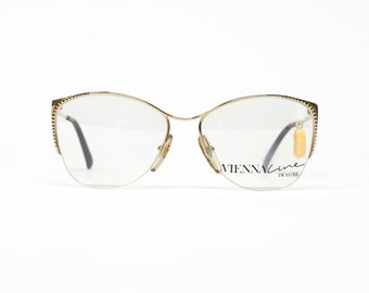 half rimmed gold eyeglass frame by vienna line made in germany with 20ct gold plated finish in unworn deadstock condition