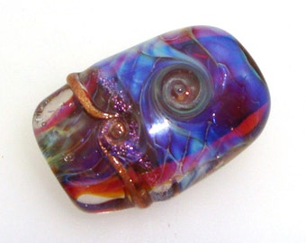 Handmade Lampwork Glass Bead Focal. Encased silver glass. Blue violet luster, sparkly goldstone, dichroic, bubble dots. Dichro, ripples.